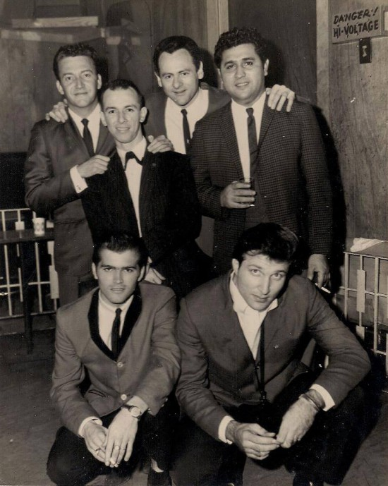 Johnny Pennino, bottom right, kneels alongside Skip Easterling as Joe Barry, upper left, Joe Lambert, Joey Long, and Freddy Fender take a break from their Papa Joe's gig.